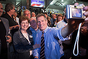 05 MARCH 2010 -- PHOENIX, AZ: US Senator Scott Brown (CQ) works the crowd and takes a photo with Amy DiIorio (CQ) from Scottsdale at Grand Canyon University in Phoenix Friday. McCain is facing a tough primary battle from former Republican Congressman JD Hayworth. McCain has Scott Brown (R-MA) and Sarah Palin campaigning for him. Both men are courting the Tea Party activists but so far the Tea Party has refused to endorse either candidate.   PHOTO BY JACK KURTZ