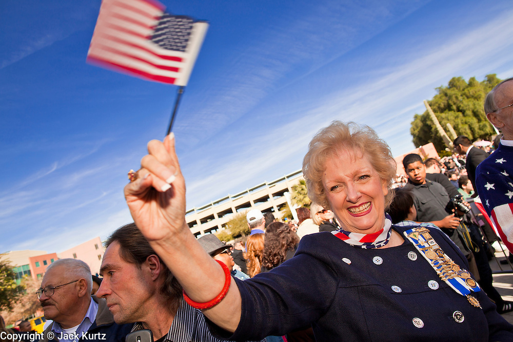 14 JANUARY 2012 - CHANDLER, AZ:    ANTOINETTE LUTTER, a member of the Daughters of the American Revolution, cheers for new US citizens at a naturalization ceremony in Chandler, AZ, Jan. 14. More than 140 people from 21 countries were naturalized as United States citizens Saturday in Chandler. This is the third year Chandler has sponsored a naturalization ceremony in connection with the Dr. Martin Luther King holiday.   PHOTO BY JACK KURTZ