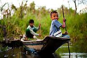 Boys steer their way around the backwaters off Inle Lake, Myanmar.