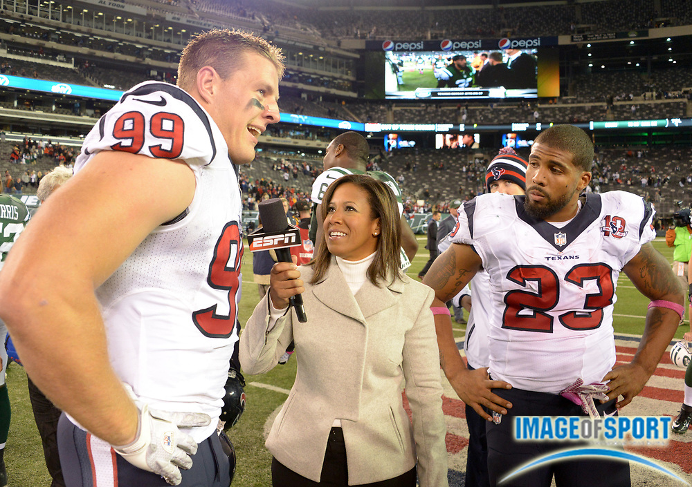 Oct 8, 2012; East Rutherford, NJ, USA; ESPN sideline reporter Lisa Salters (center) interviews  Houston Texans defensive end J.J. Watt (99) and running back Arian Foster (23) after the game against the New York Jets at MetLife Stadium. The Texans defeated the Jets 23-17.