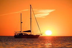 ©Licenced to London Nedws Pictures<br /> June 27 29018, Aberystwyth Wales UK<br /> <br /> UK Weather: A day of unbroken blue skies and searing 30ºc  heat comes to a beautiful end with a glorious sunset over a yacht moored in Cardigan Bay off Aberystwyth on the west coast of Wales<br /> Photo credit: Keith Morris / LNP