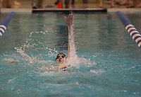Coe Brown's Zach Wood swims the 200 yard IM during the Division II Swimming and Diving Championships at UNH Sunday.  (Karen Bobotas/for the Concord Monitor)