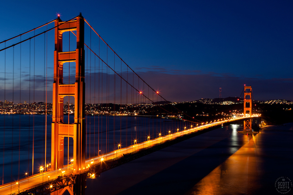 """""""Golden Gate Bridge Sunrise 1"""" - Photograph of San Francisco's famous Golden Gate Bridge at sunrise. San Francisco can be seen in the distance."""