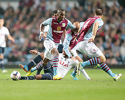 Tottenham Hotspurs' Sandro slides in on Aston Villa's Yacouba Sylla  - Photo mandatory by-line: Nigel Pitts-Drake/JMP - Tel: Mobile: 07966 386802 24/09/2013 - SPORT - FOOTBALL -  Villa Park - Birmingham - Aston Villa v Tottenham Hotspur - Round 3 - Capital One Cup