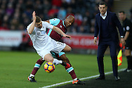 Andre Ayew of West Ham fouls Stephen Kingsley of Swansea city. Premier league match, Swansea city v West Ham United at the Liberty Stadium in Swansea, South Wales on Boxing Day, Monday 26th December 2016.<br /> pic by  Andrew Orchard, Andrew Orchard sports photography.