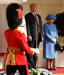 Queen Elizabeth II and US President Donald Trump look on as soldiers from the Coldstream Guards march past during a ceremonial welcome at Windsor Castle, Windsor.