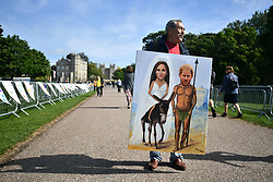 © Licensed to London News Pictures. 18/05/2018. London, UK. Artist KAYA MAR holds  up a pounding of the outside Windsor Castle. Prince Harry and Meghan Markle are to be married tomorrow (Saturday) at St George's Chapel in Windsor. Photo credit: Ben Cawthra/LNP