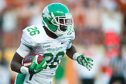 AUSTIN, TX - AUGUST 30:  Jeffrey Wilson #26 of the North Texas Mean Green breaks free against the Texas Longhorns on August 30, 2014 at Darrell K Royal-Texas Memorial Stadium in Austin, Texas.  (Photo by Cooper Neill/Getty Images) *** Local Caption *** Jeffrey Wilson