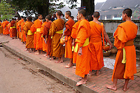 In Buddhism, alms or giving alms is the respect given by a lay Buddhist to a Buddhist monk or nun. It is not charity as presumed by Western eyes. It is closer to a symbolic connection to the spiritual and to show humility and respect.  The visible presence of monks and nuns is a stabilizing influence in Lao society. The act of alms giving assists in connects lay people to the monk and what he represents.