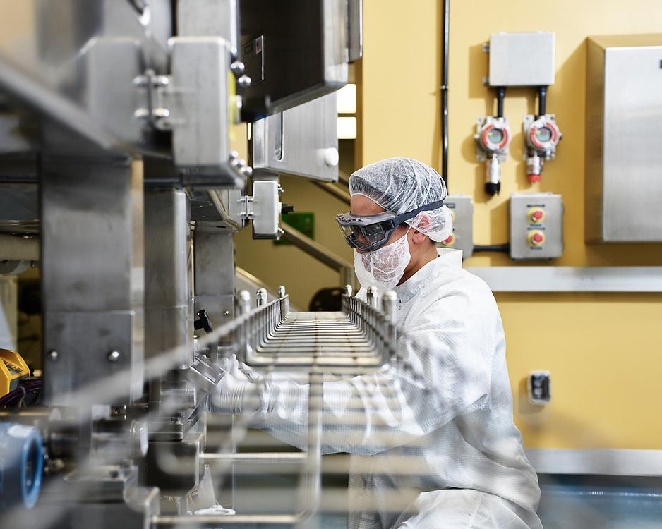 Sanofi laboratory technician working in a clean room.