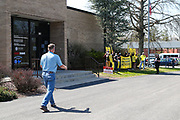 Congressman Fred Keller (R-PA) approaches a group of protesters outside of his district office in Selinsgrove, Pennsylvania on April 7, 2021. Sunrise Movement groups from Lewisburg and State College rallied outside of Keller's office to demand that he sign the Good Jobs for All Congressional Pledge.