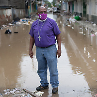 Bishop Lloyd Allen of the Episcopal Church of Honduras visited La Lima, San Pedro Sula, after hurricane Eta flooded the neighbourhood destroying people's belongings and leaving people homeless.