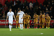 Swansea city players stand dejected as they concede a 3rd Tottenham goal. Premier league match, Swansea city v Tottenham Hotspur  at the Liberty Stadium in Swansea, South Wales on Wednesday 5th April 2017.<br /> pic by Andrew Orchard, Andrew Orchard sports photography.