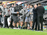 Football - 2020 / 2021 Sky Bet Championship - Play-offs - Semi-final, second leg - Swansea City vs Barnsley - Liberty Stadium.<br /> <br /> Swansea Manager Steve Cooper  commiserates with Barndsley manager Valerien Ismael as his staff celebrates victory in the background<br /> <br /> COLORSPORT/WINSTON BYNORTH