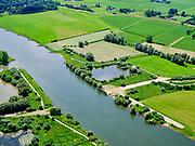 Nederland, Overijssel, Gemeente Olst, 21–06-2020; stuw Olst, restant van de IJssellinie (waterlinie) gebouwd tijdens de Koude Oorlog. Lokatie van de stuw in rivier de IJssel, de betonnen weg vormde de ondergrond van de afsluitbare pijlerdam die uitkwam op het landhoofd (de betonnen muur). Oorspronkelijk stond op beide oevers zo'n landhoofd waartegen, aan de rivierzijde caissons afgezonken konden worden. Hierdoor zou het rivierwater het omliggende land doen overstromen (inunderen). Ook de haven voor de caissons, het vierkante water direct naast de rivier, is nog aanwezig.<br /> Barrage Olst, remnant of the IJssel line (water line) was built during the Cold War. Location of the Barrage in the river IJssel, under the concrete road was the pillar dam, at the end of the road the and abutment (the concrete wall). Originally, such abutments were on both banks and were used to position caissons (on the river side) that subsequently could be sunk. This would make the river flood the surrounding land (inundation). <br /> <br /> luchtfoto (toeslag op standaard tarieven);<br /> aerial photo (additional fee required)<br /> copyright © 2020 foto/photo Siebe Swart