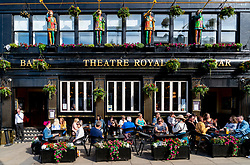 View of busy outside terrace of Theatre Royal bar on Leith Walk at Picardy Place in Edinburgh , Scotland, UK