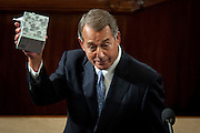 The day before he is to retire from Congress, Speaker of the House John Boehner (R-OH) shows off his box of tissue as he prepares to deliver his farewell address to the House of Representatives on October 29, 2015 in Washington, D.C. Following his address, the House of Representatives will vote on Boehner's replacement for Speaker.