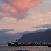 Sunset over small seaside port near Capetown, South Africa.