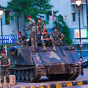 BEIRUT,LEBANON - JUNE 2009 :Lebanese soldiers sit on top of their armored vehicle secure the area around in Place Sassine , in Beirut's Ashrafieh Christian stronghold  where will celebrate their victory in Lebanon's parliamentary elections on June 08, 2009 . Beirut. Lebanon. 06/06/2009 ( Photo by Jordi Cami)