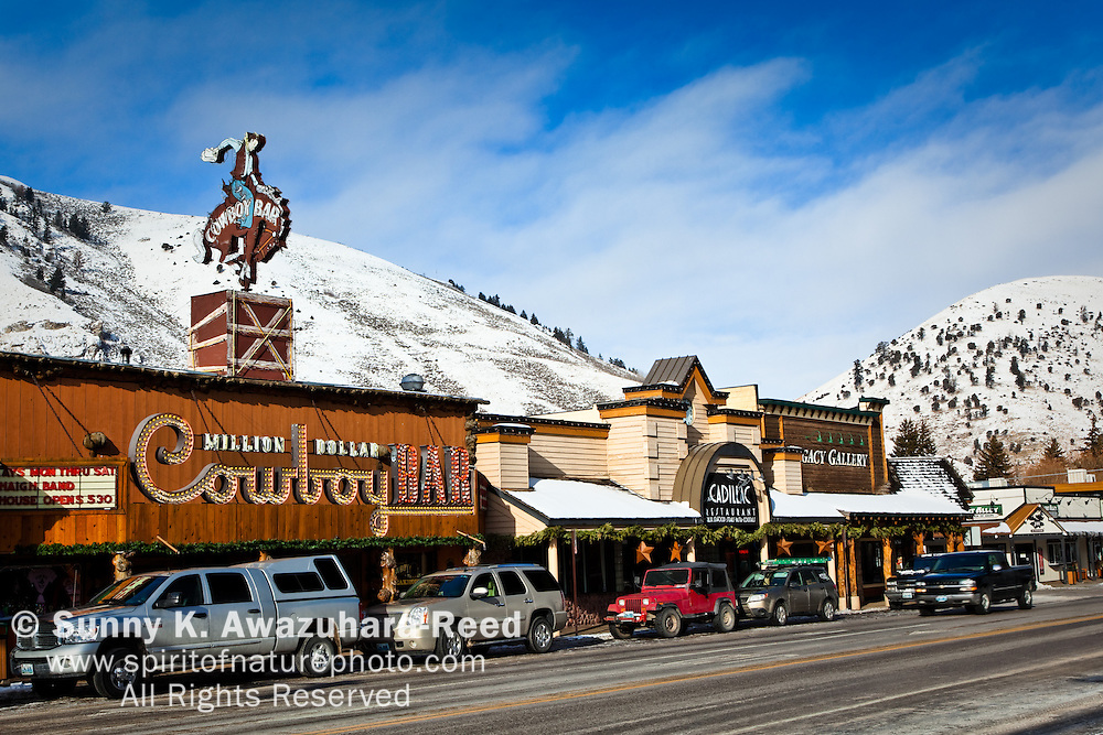 The Million Dollar Cowboy Bar at Town Square, Jackson Hole, WY on a sunny day.  A snowy mountain in the background.  Winter Scene.