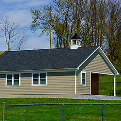 Narvon, PA / USA - May 3, 2020: A small one-room schoolhouse used by the Amish community to educate their youth in rural Lancaster County.