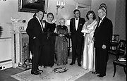President John F. Kennedy entertained at a dinner party given by President Éamon de Valera at Áras an Uachtaráin. Included in the group are An Taoiseach Seán Lemass, Mrs de Valera and Mrs Eunice Shriver.