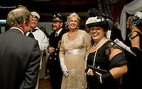 Andrew Hosmer, Joe Kildune, Cindy Reinartz and Donna Hosmer are welcomed to an evening aboard the Titanic with the Winnipesaukee Playhouse on Saturday night at Gunstock Mountain Lodge.  (Karen Bobotas/for the Laconia Daily Sun)