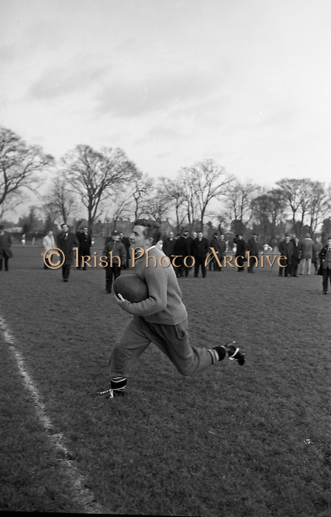 Captain of UCC, McGrath, at speed during practice in Dublin, Friday 12th February, 1965,..Irish Rugby Football Union, Ireland v England, Five Nations, Irish Rugby team practice, Dublin, Ireland, Friday 12th February, 1965,.13.2.1965, 2.13.1965,..Referee- H S Laidlaw, Scottish Rugby Union, ..Score- Ireland 5 - 0 England, ..Irish Team, ..T J Kiernan,  Wearing number 15 Irish jersey, Full Back, Cork Constitution Rugby Football Club, Cork, Ireland,..P J Casey, Wearing number 14 Irish jersey, Right Wing, Landsdowne Rugby Football Club, Dublin, Ireland, ..M K Flynn, Wearing number 13 Irish jersey, Right Centre, Wanderers Rugby Football Club, Dublin, Ireland, ..K J Houston, Wearing number 12 Irish jersey, Left Centre, Bruff Rugby Football Club, Limerick, Ireland, and, Oxford University Rugby Footabll Club, Oxford, England,..P J McGrath,  Wearing number 11 Irish jersey, Left Wing, University college Cork Rugby Football Club, Cork, Ireland,..C M H Gibson, Wearing number 10 Irish jersey, Stand Off, Cambridge University Rugby Football Club, Cambridge, England, and, N.I.F.C, Rugby Football Club, Belfast, Northern Ireland, ..R M Young, Wearing number 9 Irish jersey, Scrum Half, Queens University Rugby Football Club, Belfast, Northern Ireland,..S MacHale, Wearing number 1 Irish jersey, Forward, Landsdowne Rugby Football Club, Dublin, Ireland, ..K W Kennedy, Wearing number 2 Irish jersey, Forward, Queens University Rugby Football Club, Belfast, Northern Ireland,..R J McLoughlin, Wearing number 3 Irish jersey, Captain of the Irish team, Forward, Gosforth Rugby Football Club, Newcastle, England, ..W J McBride, Wearing number 4 Irish jersey, Forward, Bective Rangers Rugby Football Club, Dublin, Ireland,  ..W A Mulcahy, Wearing number 5 Irish jersey, Forward, Bective Rangers Rugby Football Club, Dublin, Ireland,  ..M G Doyle, Wearing number 6 Irish jersey, Forward, University College Dublin Rugby Football Club, Dublin, Ireland,..R A Lamont, Wearing number 8 Irish jersey, Forward, Inst