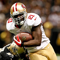 November 25, 2012; New Orleans, LA, USA; San Francisco 49ers running back Frank Gore (21) runs past New Orleans Saints strong safety Roman Harper (41) during the second half of a game at the Mercedes-Benz Superdome. The 49ers defeated the Saints 31-21. Mandatory Credit: Derick E. Hingle-US PRESSWIRE
