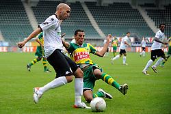 22-07-2009 VOETBAL: ADO DEN HAAG - VALENCIA CF: DEN HAAG<br /> Valencia wint met 4-1 van Den Haag / Wesley Verhoek in duel met Garcia<br /> ©2009-WWW.FOTOHOOGENDOORN.NL