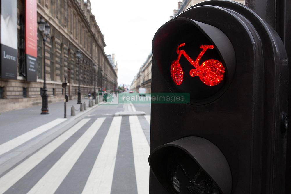 Red light for cyclist on Rivoli Street in Paris on May 4, 2020, on the forty-ninth day of a strict lockdown in France, in place to attempt to stop the spread of the new coronavirus (COVID-19). Photo by Raphael Lafargue/ABACAPRESS.COM