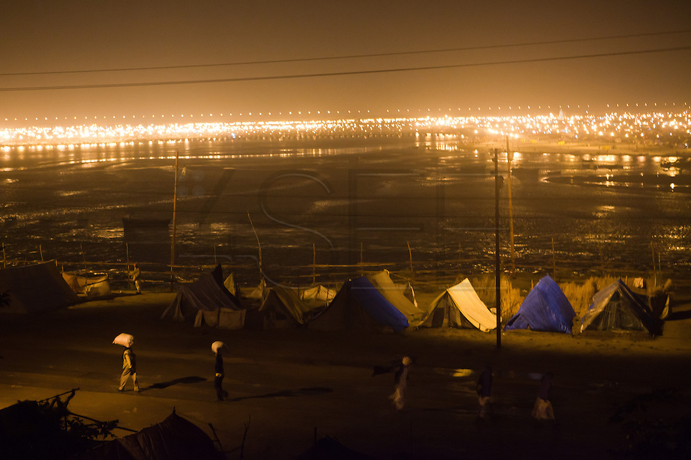 Millions of tents are installed for the pilgrims. Allahabad, February 2013. // The Maha Kumbh Mela is believed to be the single largest religious gathering in the world. It's a sacred pilgrimage celebrated every twelve years. In 2013 it has taken place in Allahabad, in the confluence of the rivers Ganga, Yamuna and Saraswati. Millions of hindu people gather on a single day for a ritual bath in the sacred waters of Ganga. The event congregate millions of devotees, sadhus and sadhvis of all the akharas coming from all over India.