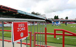 A general view of the Red Zone signage at the Wham Stadium as the Peterborough United players warm-up - Mandatory by-line: Joe Dent/JMP - 12/09/2020 - FOOTBALL - Wham Stadium - Accrington, England - Accrington Stanley v Peterborough United - Sky Bet League One