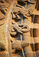 Norman Romanesque relief sculptures of dragons and mythical creatures from the South doorway of Church of St Mary and St David, Kilpeck Herifordshire, England. Built around 1140 .<br /> <br /> Visit our MEDIEVAL PHOTO COLLECTIONS for more   photos  to download or buy as prints https://funkystock.photoshelter.com/gallery-collection/Medieval-Middle-Ages-Historic-Places-Arcaeological-Sites-Pictures-Images-of/C0000B5ZA54_WD0s