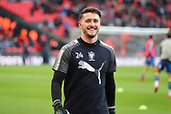 AFC Wimbledon goalkeeper Joe McDonnell (24) smiling during the The FA Cup 3rd round match between Tottenham Hotspur and AFC Wimbledon at Wembley Stadium, London, England on 7 January 2018. Photo by Matthew Redman.