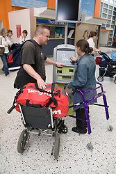Couple using the express checkin at airport,
