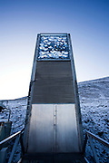 """Nestled into the rocky waste of plataberget Mountain about Svalbard's airport, the Global Seed Vault is at once startling and innocuous. Designed by architect Peter W. Søderman at Barlindhaug Consulting, this concrete, steel and glass structure is the first layer of security to a repository of millions of seeds from around the world, stored here in case of disaster, disease, or war...The Svalbard Global Seed Bank is situated 120 metres (390 ft) inside a sandstone.mountain at Longyearbyen on Spitsbergen Island, in the Svalbard archipelago about 1300km from the North Pole. Svalbard was considered ideal for the bank, due to low tectonic activity and its permafrost, which will aid preservation. Even if sea levels rise due to climate change - and the melting of ice caps, the seeds will be safe and dry , as they are stored at a location 130 metres (430 ft) above sea level. ..The Svalbard Global Seed Vault  provides a safety net against accidental loss of diversity from traditional storage within genebanks around the world, and has a capacity for 4.5 million seeds. Although the media has made much of the """"Doomsday Vault's"""" role in providing security in the face of war or or catastrophe, the operators - the Norwegian government  and the Global Crop Diversity Trust and the Nordic Genetic Resource Center - say that it will be most useful when genebanks lose samples due to mismanagement, accident, equipment failures, funding cuts and natural disasters. <br /> <br /> This mage can be licensed via Millennium Images. Contact me for more details, or email mail@milim.com <br /> <br /> For giclée prints, contact me, or click """"add to cart"""" to some standard print options."""