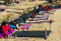 Puno, Peru - July 25, 2013: women weaving in the peruvian Andes at Taquile Island on Puno Peru at july 25th, 2013.