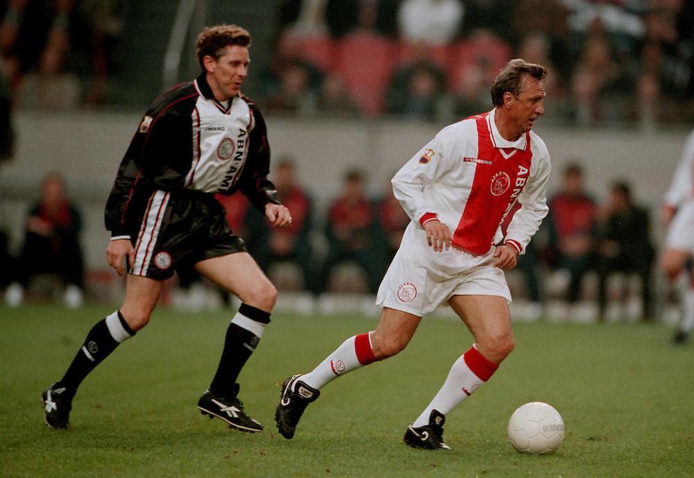 Photo: Gerrit de Heus. Amsterdam. 06/04/99. Johan Cruijff(R) playing with and against former Ajax-players. Arnold Muhren(L). Keywords: Cruyff