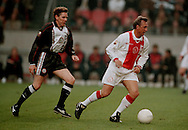 Photo: Gerrit de Heus. Amsterdam. 06/04/99. Johan Cruijff(R) playing with and against former Ajax-players. Arnold Muhren(L). Keywords: Cruyff