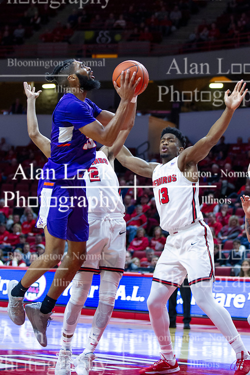 NORMAL, IL - January 29: K.J. Riley leans into a shot while defended by Zach Copeland and Rey Idowu during a college basketball game between the ISU Redbirds and the University of Evansville Purple Aces on January 29 2020 at Redbird Arena in Normal, IL. (Photo by Alan Look)