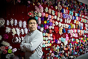 Yu Hexi, owner of  the Yiwu Beautiful Flower Co. Ltd, stands in his showroom in Yiwu, Zhejiang Province, China on 06 March  2013. The city of Yiwu is known as one of China's largest trading centers for small merchandise and light industry, drawing buyers from around the world. Uncertain global demand, a stronger yuan currency and rising labour costs have taken their toll on Chinese exporters, but analysts believe sales could pick up modestly in 2014 due to improved demand from the United States and Europe.