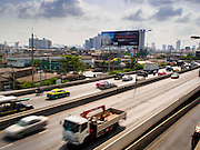 20 APRIL 2015 - BANGKOK, THAILAND:   Traffic on Thanon Ratchapruk in the Thonburi section of Bangkok. Looking east back towards Bangkok.    PHOTO BY JACK KURTZ