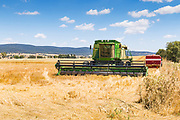 John Deere 9610 combine harvester after cutting the last of the wheat crops as the harvest season comes to an end near Toogong, New South Wales, Australia <br />