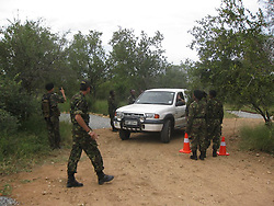 July 7, 2015 - BALULE RESERVE, SOUTH AFRICA: Black Mamba roadblock checks for illegal animal parts. LED BY BRITISH former military personnel these pictures show how courageous women anti-poachers train with guns in their battle to preserve Africa's endangered animals. Operating in the Kruger National Park's Balule Nature Reserve the 24-member strong all-female Black Mamba Anti-Poaching Unit patrols 50,000 hectares of bush to protect elephants and rhinos that are hunted as part of the estimated £12billion a year illegal world animal trade. These ladies, who as pictures show pose with weapons but also know how to party, are on the front line of a deadly war for the resources of their continent. Over the past year 1,000 wildlife rangers have been killed in Africa while protecting endangered wildlife. Black Mamba Commander and former Royal Navy serviceman Russell Baker (28) from Grimsby, UK explained exclusively how and why this South African special unit was established. (Credit Image: © Media Drum World/MediaDrumWorld/ZUMAPRESS.com)