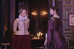 """© Licensed to London News Pictures. 14 January 2014. London, England. L-R: SARAH MacRAE as Cariola and GEMMA ARTERTON as The Duchess. Actress Gemma Arterton stars as the Duchess in the play """"The Duchess of Malfi"""" by John Webster. This is the first production to take place at the Sam Wanamaker Playhouse at the Globe Theatre. The performance is only lit by candles. Directed by Dominic Dromgoole. Photo credit: Bettina Strenske/LNP"""