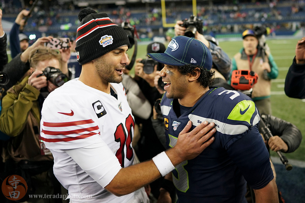 December 29, 2019; Seattle, Washington, USA; San Francisco 49ers quarterback Jimmy Garoppolo (10, left) talks to Seattle Seahawks quarterback Russell Wilson (3, right) after the game at CenturyLink Field.