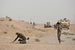 © Licensed to London News Pictures. 30/09/2015. Kirkuk, Iraq.<br /> <br /> Supported by large amounts of coalition airstrikes, members of the Iraqi-Kurdish peshmerga today (30/09/2015) took part in an offensive to take seven villages across a large front near Kirkuk, Iraq. By mid afternoon the Kurds had reached most of their objectives, but suffered around 10 casualties all to improvised explosive devices. All seven villages were originally Kurdish and settled with other ethnic groups during the Iraqi Arabisation process of the 1970's and 80's. Photo credit: Matt Cetti-Roberts/LNP
