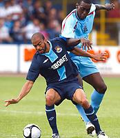 Kieron Dyer ( West Ham ).  Nick McKoy( Grays ). Pre-Season Friendly Grays Athletic v West Ham United <br /> at The New Recreation Ground<br /> 12/07/2009 Credit Colorsport / Kieran Galvin