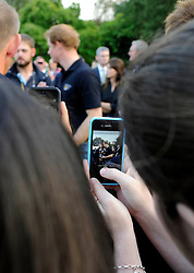 A member of the public takes a photo of his Royal Highness Prince Harry at the Winfield reception - Photo mandatory by-line: Joe Meredith/JMP - Mobile: 07966 386802 - 9/09/14 - Winfield reception for the Invictus Games - London - Winfield House